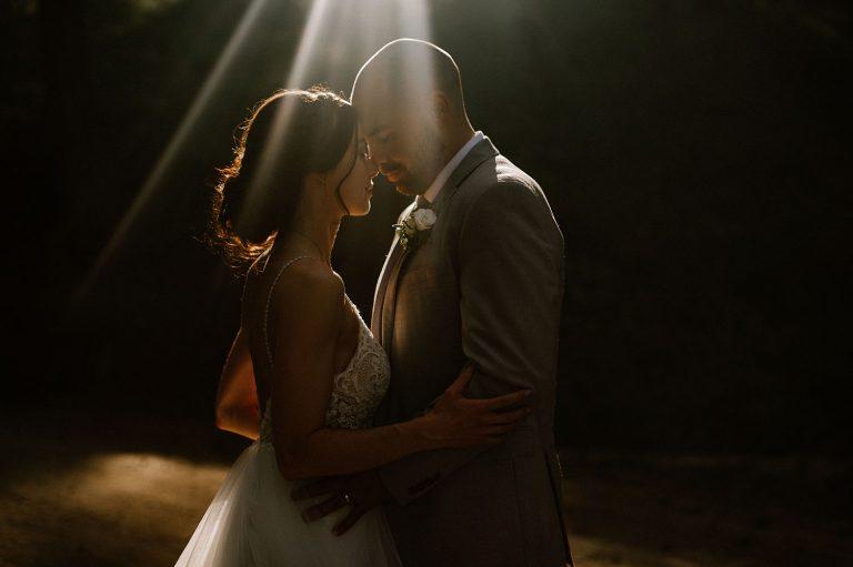 Golden sunbeam shining on bride and groom during Okanagan Wedding Portraits