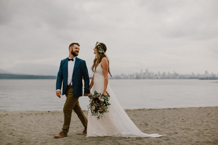 intimate vancouver wedding candid portrait at spanish banks beach