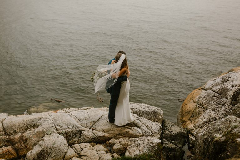 Foggy West Vancouver elopement with bride and groom embracing