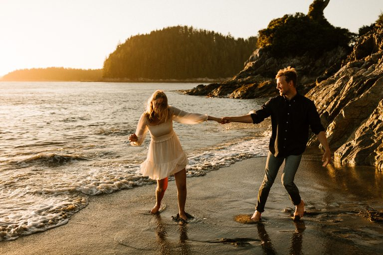 Candid moments with a couple on the beach during Tofino engagement session